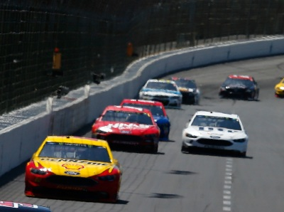 Joey Logano leads the pack at Texas.  (NASCAR Photo)