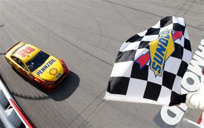 Joey Logano's #22 crosses the finish line first at Richmond.  (NASCAR Photo)