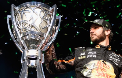 Martin Truex, Jr. and his Cup.  (NASCAR Photo)