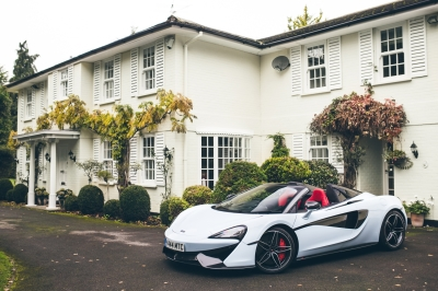 A Muriwai White McLaren 570 Spider in front of the Muriwai House.  (McLaren Photo)