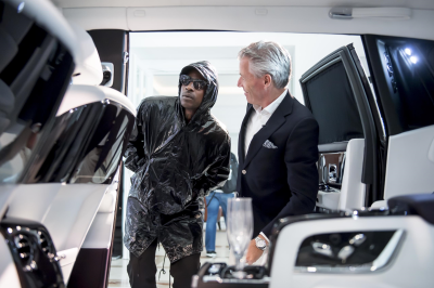 Skepta looks over the interior of a Rolls-Royce.  (Rolls-Royce Photo)