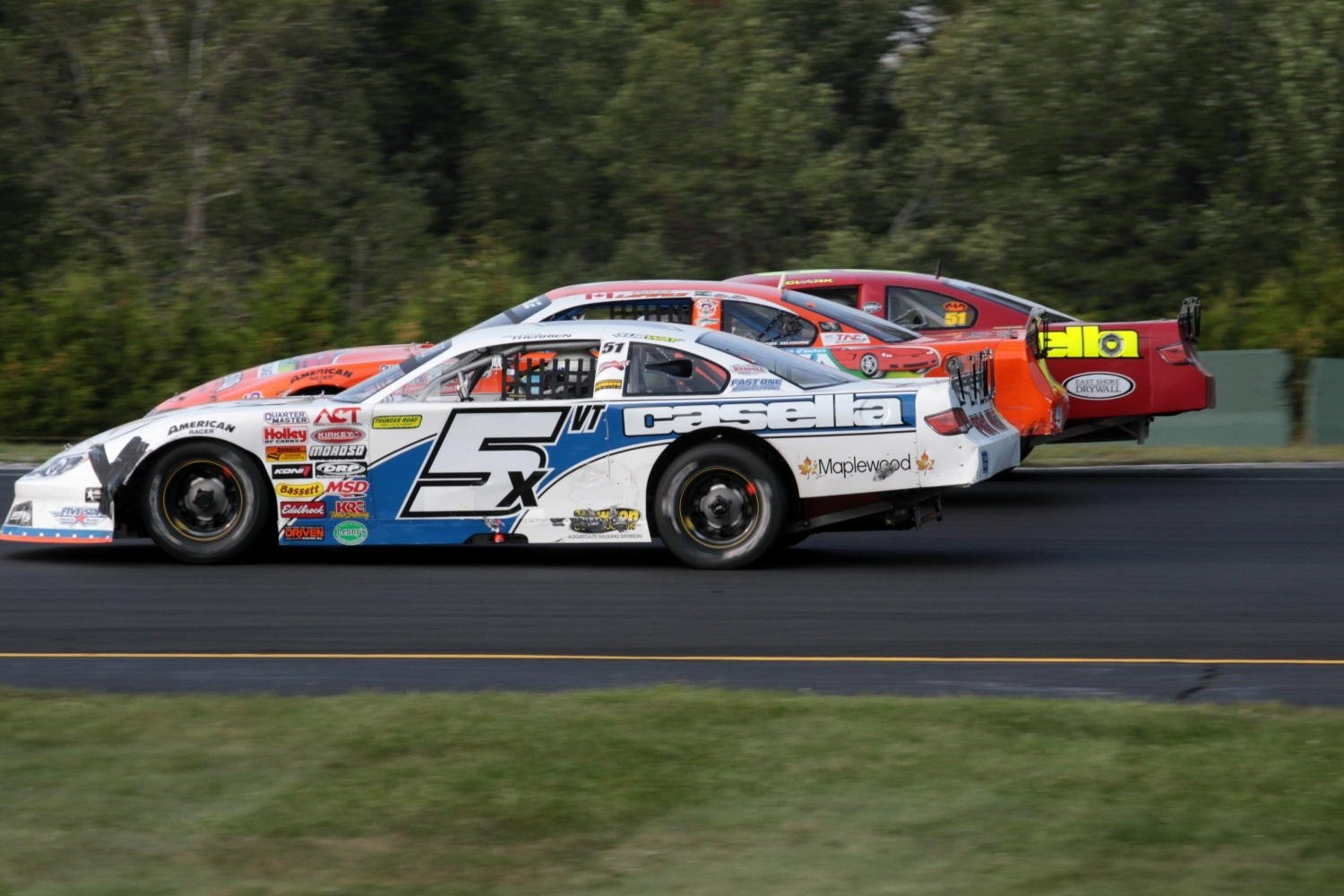 Three wide action at Thunder Road.  (Alan Ward Photo)